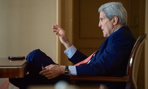 John Kerry speaks to staff during a break in Iran negotiations in Switzerland last week.