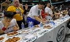Competitive eaters feast on wings during the 2012 Wing Bowl in Philadelphia.