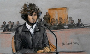 Boston Marathon bombing suspect Dzhokhar Tsarnaev is depicted in a courtroom sketch sitting in federal court in Boston Thursday, Dec. 18, 2014.