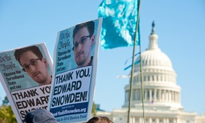 Protestors rally in support of Edward Snowden in 2013.
