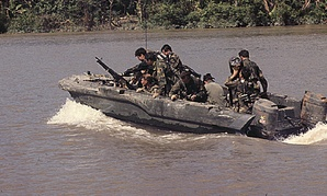 Members of U.S. Navy SEAL Team One move down Bassac River in a SEAL Team assault boat, November 19, 1967.