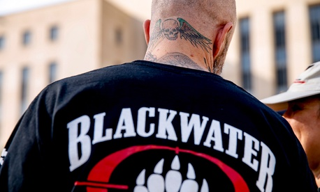 A former member of Blackwater joines family members, friends, and supporters of four former Blackwater security guards outside the federal court Monday.