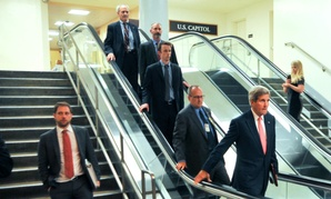 Secretary of State John Kerry heads through the Capitol to a briefing with House members on Iran negotiations.