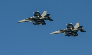 Two EA-18G Growlers from the Cougars of Electronic Attack Squadron conduct a flight test in November.