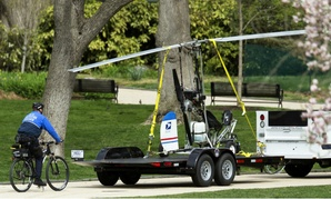 Capitol Police haul away the gyrocopter a U.S. Postal Service worker was able to land on the Capitol lawn earlier this week.