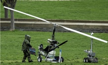 A bomb squad member checks the gyrocopter that a U.S. Postal Service worker landed on the lawn of the Capitol on April 15.