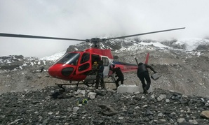A rescue chopper lands carrying people from higher camps to Everest Base Camp, Nepal, Monday after the weekend earthquake.