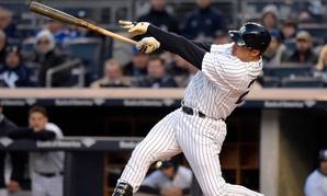 New York Yankees' Mark Teixeira hits a two-run home run during a game Friday.
