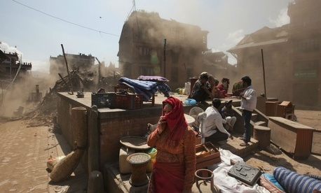 Residents of Nepal gather amid the destruction caused by Saturday's earthquake.