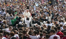 Pope Francis greets pilgrims in Vatican City in 2014.