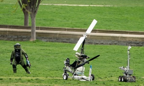A member of a bomb squad approaches the gyrocopter after it landed in April.