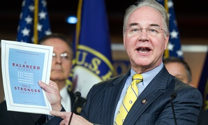 House Budget Committee Chairman Rep. Tom Price, R-Ga. holds-up a synopsis of the House Republican budget proposal in March.