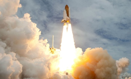 The space shuttle Atlantis launches from the Kennedy Space Center in July 2011.