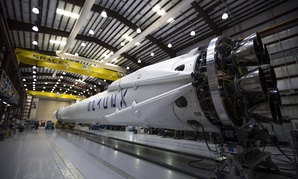 The CRS-6 Falcon sits in a hangar.