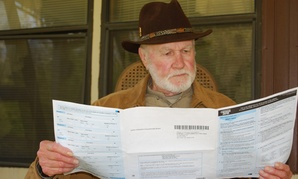 A farmer reads over the 2010 Census form.