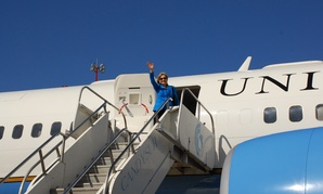 Clinton waves goodbye before lifting off from Montevideo, Uruguay in 2010.