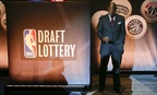 Miami Heat VP Alonzo Mourning checks his cellphone before the NBA draft lottery in May.