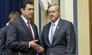 Reps. Jason Chaffetz and Mark Meadows confer after a hearing in September 2014. The two got in a fight over Meadows' vote on fast-track trade authority, but on Thursday announced they had reconciled.