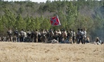 Civil War re-enactors hold up the flag in South Carolina in 2012.