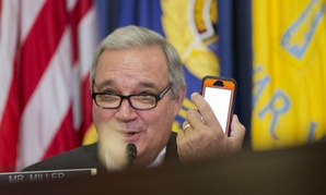 In February, House Veterans' Affairs Committee Chairman Rep. Jeff Miller, R-Fla., conveys a message from his mobile phone to VA Secretary Robert McDonald, a witness.
