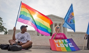 Two demonstrators hold up flags outside the Supreme Court Friday.