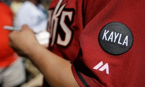 "Arizona Diamondbacks' Vidal Nuno wears a black patch with ""KAYLA"" on his sleeve in memory of Prescott, Ariz., resident Kayla Mueller who died in ISIS captivity."