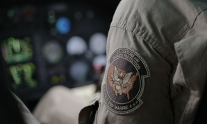 A U.S. Customs and Border Protection Air and Marine agent's patch is seen as he patrols patrol near the Texas-Mexico border in February.