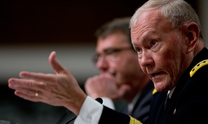 Martin Dempsey gestures as Ashton Carter listens during testimony Tuesday.