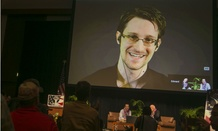 Edward Snowden appears on a live video feed from Moscow in February.
