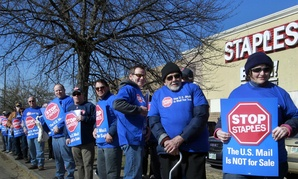 Postal workers protest outside a Staples in New Hampshire in April 2014.