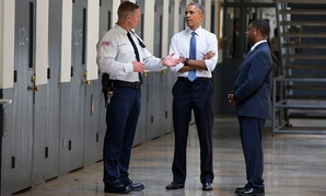 Obama is led on a tour by Bureau of Prisons Director Charles Samuels, right, and correctional officer Ronald Warlick Thursday at Oklahoma's El Reno Federal Correctional Institution.