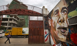 A pedestrian walks past a mural of President Barack Obama at the GoDown Arts Centre in Nairobi.