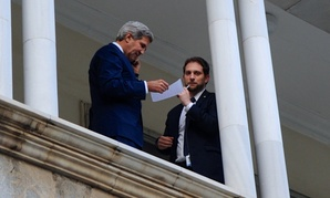 John Kerry stands with Deputy Chief of Staff Jon Finer on a balcony at Haram Saray Palace in Kabul in 2013.