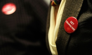 A health care worker in Minnesota wears a button supporting the Affordable Care Act in 2013.