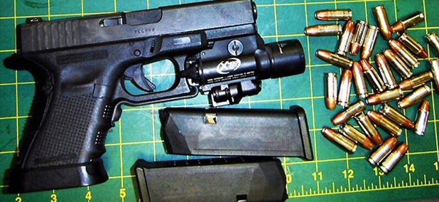 TSA posts photos of guns -- like this one found in baggage at McCarran International Airport in early July -- found by agents on Instagram.