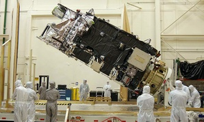 The fully-integrated GOES-R satellite is shown in a clean room at a Lockheed Martin facility in Littleton, Colorado.