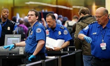 Agents work at  Seattle-Tacoma International Airport in March.