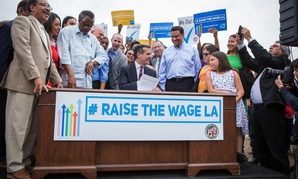 Mayor Garcetti signs the minimum wage ordinance into law, raising the minimum wage in Los Angeles to $15.00 by 2020.