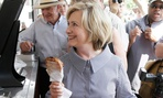 Clinton enjoys a pork chop at the Iowa State Fair over the weekend.