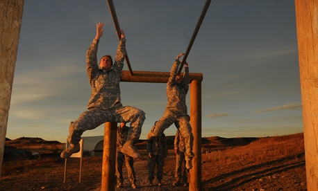 Shaye Haver, left, traverses an obstacle during the Ranger Assessment held at Fort Carson in October.