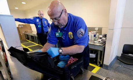 An agent checks a bag at O'Hare international Airport in November.