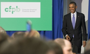 President Obama announces a plan to strengthen security for debit cards that transmit federal benefits, in October 2014.