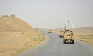 A Marine Corps convoy travels through Afghanistan in May 2014.
