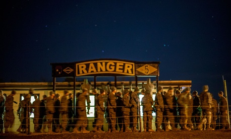 "Ranger students from Charlie Company, 5th Ranger Training Battalion do pull-ups before breakfast at ""Mountain Phase"" in 2014."