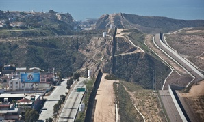 The current fence runs in places along the border, such as this segment near San Diego.