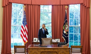 President Obama talks to Solicitor General Donald Verrilli in the Oval Office after learning of the Supreme Court's ruling on the Patient Protection and Affordable Care Act, June 28, 2012.