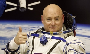 U.S. astronaut Scott Kelly, crew member of the mission to the International Space Station, ISS, gives a thumbs up prior the launch of a Soyuz-FG rocket.
