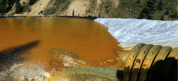 Water flows through a series of sediment retention ponds built to reduce heavy metal and chemical contaminants from the Gold King Mine wastewater accident.