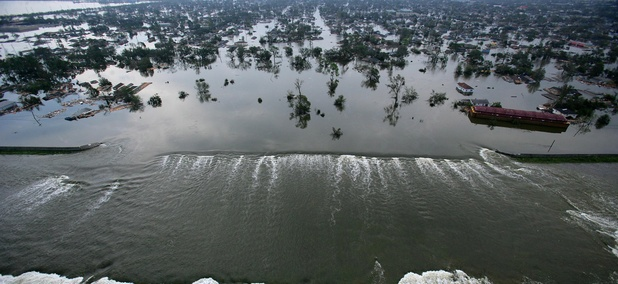 Floodwaters pour through a levee near downtown New Orleans on Aug. 30, 2005.