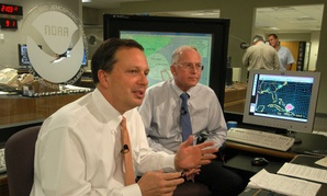 FEMA Director Michael Brown, left, discusses preparation efforts for Hurricane Frances Sept. 1, 2004, at the National Hurricane Center in Miami with NHC director Max Mayfield.